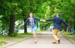 Couple having fun in a park Royalty Free Stock Photography