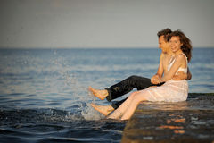 Couple having fun on a pier Stock Image