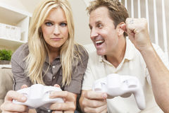 Couple Having Fun Playing Video Console Game Stock Photo