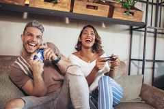 Couple having fun while playing video games. Beautiful couple having fun while playing video games Stock Photography