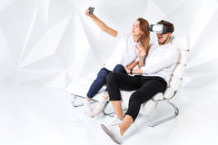 Couple having fun playing with virtual reality Royalty Free Stock Image