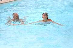 Couple having fun in pool Stock Photography