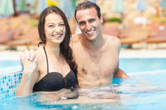 Couple Having Fun In Pool Stock Images