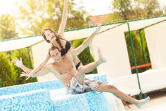 Couple Having Fun In Pool Royalty Free Stock Photos