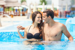 Couple Having Fun In Pool Stock Photo