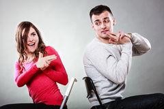 Couple having fun pretend hands fingers are guns. Royalty Free Stock Image