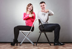 Couple having fun pretend hands fingers are guns. Royalty Free Stock Photography