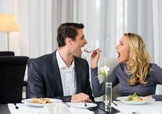 Couple having fun in restaurant Stock Images