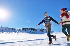 Couple having fun running down slope Royalty Free Stock Photos