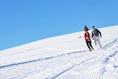 Couple having fun running down slope Stock Photos