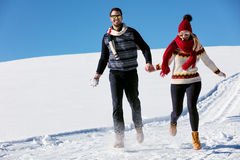 Couple having fun running down slope Stock Photos