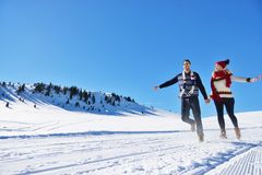 Couple having fun running down slope Royalty Free Stock Images