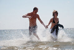 Couple having fun at the sea Royalty Free Stock Photo