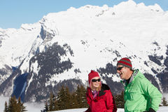 Couple Having Fun On Ski Holiday In Mountains. Laughing Royalty Free Stock Images