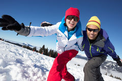 Couple Having Fun On Ski Holiday In Mountains. Smiling At Camera Stock Image