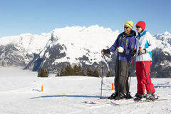 Couple Having Fun On Ski Holiday In Mountains. Looking Off Into The Distance Stock Images
