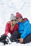 Couple Having Fun On Ski Holiday In Mountains Stock Photography