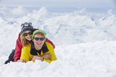 Couple Having Fun On Ski Holiday In Mountains Stock Photo