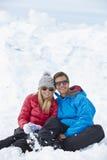 Couple Having Fun On Ski Holiday In Mountains Stock Photo