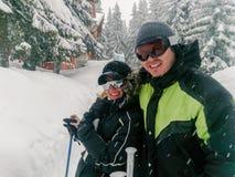 Couple Having Fun On Ski Holiday In Mountains royalty free stock photos