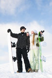 Couple having fun on snowboard stock images