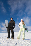Couple having fun on snowboard Stock Image