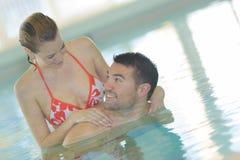 Couple having fun in swiming pool. Couple is having fun in swiming pool Royalty Free Stock Photos