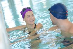 Couple having fun in swiming pool. Couple is having fun in swiming pool Royalty Free Stock Images