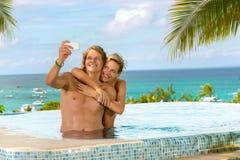 Couple having fun in swimming pool Royalty Free Stock Image