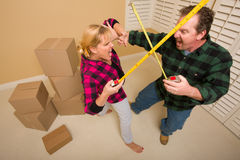 Couple Having Fun Sword Fight with Tape Measures Royalty Free Stock Images