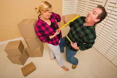 Couple Having Fun Sword Fight with Tape Measures Stock Image