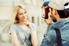 Couple having fun taking photos with retro vintage hipster camer Stock Image