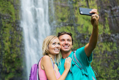 Couple having fun taking pictures together outdoors on hike Royalty Free Stock Photo