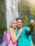 Couple having fun taking pictures together outdoors on hike Stock Photo