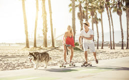 Couple having fun with their dog. Stock Image
