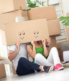 Couple having fun in their new house Stock Images