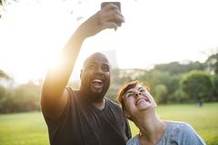 Couple having fun together at the park Stock Photo