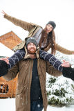 Couple having fun together in snowy weather Royalty Free Stock Image