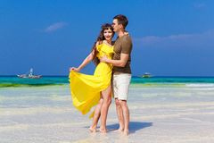 Couple having fun on tropical beach. Summer vacation concept. Royalty Free Stock Image