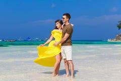 Couple having fun on tropical beach. Summer vacation concept. Stock Photos