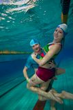 Couple having fun underwater in the pool Royalty Free Stock Photos