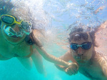 Couple having fun underwater in the sea Royalty Free Stock Image