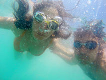 Couple having fun underwater in the sea Stock Image