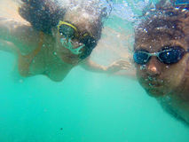 Couple having fun underwater in the sea Royalty Free Stock Photo