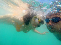 Couple having fun underwater in the sea Stock Photography