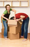 Couple having fun while unpacking Royalty Free Stock Image