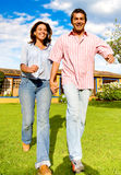 Couple having a fun walk Stock Photos
