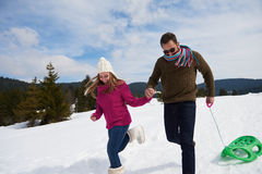 Couple having fun and walking in snow shoes Stock Images