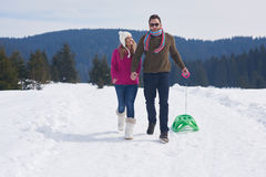 Couple having fun and walking in snow shoes Royalty Free Stock Images