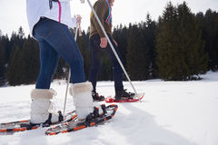 Couple having fun and walking in snow shoes Royalty Free Stock Photos